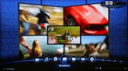 Menyn är toppen på den egna mediespelardelen som gör TizzBird så mångsidig. Här finns även stödet för 3D-film, 24p-uppspelning, hd-ljud och undertexter med valbar placering, storlek och färg. På bilden ovan är tv-mottagaren igång och visar tv-bilden som bakgrund.